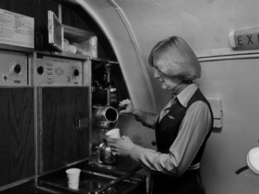 JAN 15 1979, JAN 23 1979, JAN 28 1979; Frontier Airlines attendant samples coffee before taking off